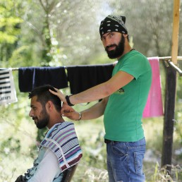Wasim's makeshift hair salon. Photo: Phil Le Gal / Hans Lucas.
