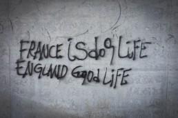 France is dog life, England good life graffiti, Calais, France. June 2015